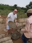 George carrying concrete for the health clinic.