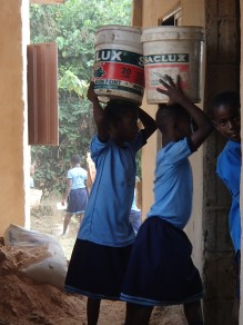 children help us bring by bringing in dirt, rocks and water