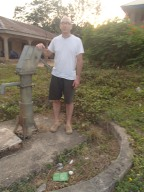 George with well at Presbyterian church which he helped dig in 2004