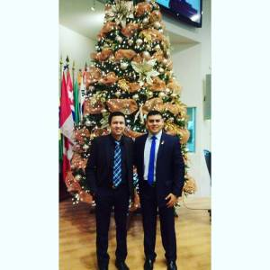 Jorge (left) with a friend at work during the Christmas season.